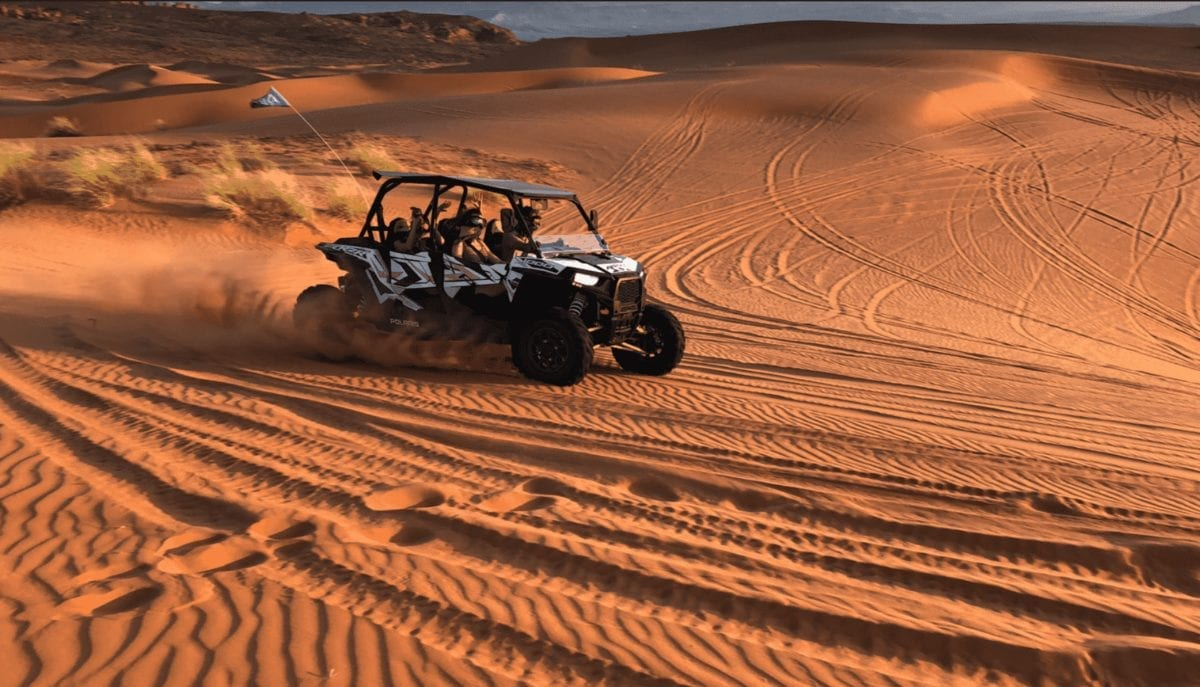 A side-by-side riding the dunes in Southern Utah. Activities to do at Sand Hollow Resort.