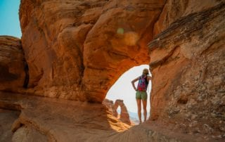 Woman standing in natural arch